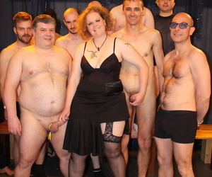Mature redhead with large breasts lives out her gangbang..