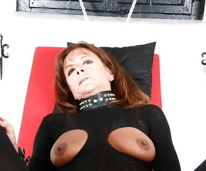 Mature European sex slave is bound and blindfolded by Lady..