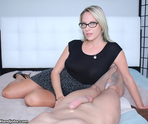 Clothed middle aged lady Vicky Vixxx jacks off a cock..