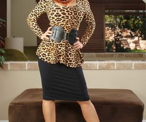 Brunette female Lisa Ann doffs a black skirt on way to..