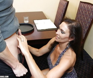 Lusty mature lady gives a handjob and receives a cumshot..