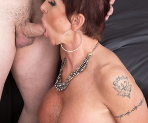 Mature lady Gina Milano opens her mouth wide for a cumshot..
