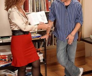 Busty mature librarian Demi La Rue seduces a young boy..