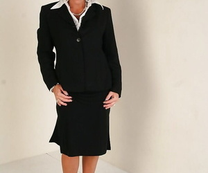 Busty mature gal Kendra Secrets gets rid of her dress..