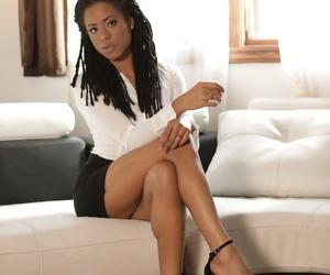 Ebony solo girl Kira Noir shows some leg before removing..