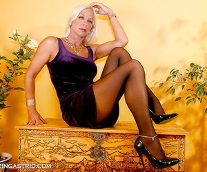 Stunning mature blonde in pantyhose stripping off her..