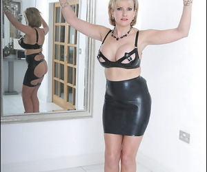 Stunning mature fetish lady with enhanced tits posing in..