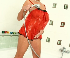Busty woman Pandora oils big natural tits in shower and..