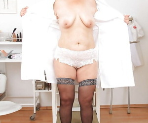 Mature slut in nurse uniform spends her spare time with..