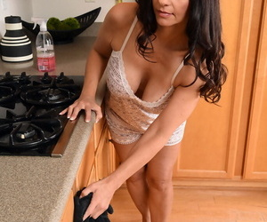 Big titted mature Mindi Mink strips in the kitchen to show..