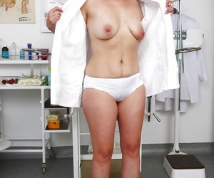 Chubby mature nurse bares saggy tits while inserting..