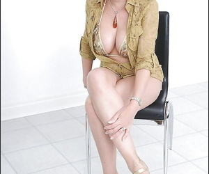 Lusty mature bombshell uncovering her big tatas and..