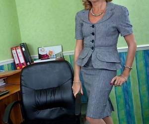 Smiley mature blonde in nylons undresses and bends over to..