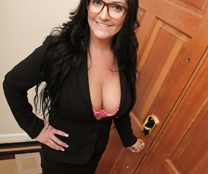 Sassy mature lady in glasses revealing her massive jugs..