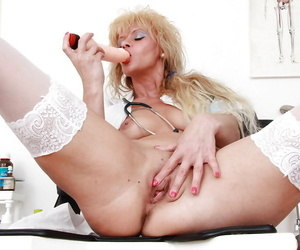Sassy mature nurse stuffing her twat with a vibrator and..