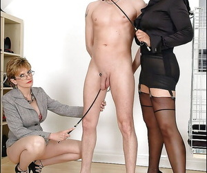 Lusty mature femdoms on high heels torturing a swollen cock