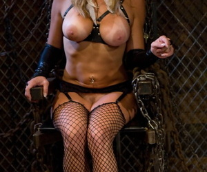 Hot blonde in fishnets and boots has her male sub lick her..