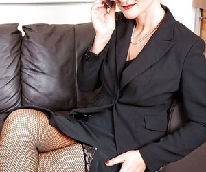 Mature secretary in glasses stripping and vibrating clit..