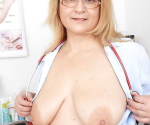 Uniformed fatty Jitule teases her mature pussy while..