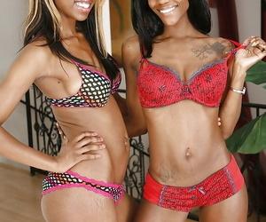 Frisky ebony girls in snazzy lingerie revealing their..