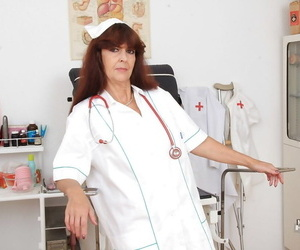 Mature european Lada masturbating her old pussy in nurse..