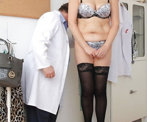 Older woman Remy strips down to underwear and stockings in..