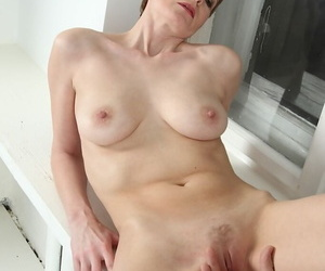 Aged mature lady Nensy having her pussy fingered before..