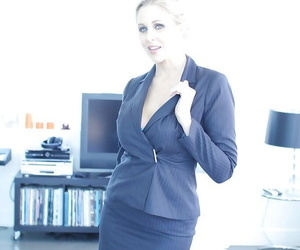 Buxom mature blond Julia Ann removing business suit to..