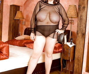 Mature fatty posing in a see-thru nighty and showing giant..