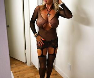 Hot older blonde housewife Sandra Otterson modelling mesh..