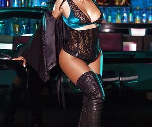 Stripper boot adorned mature brunette centerfold babe..