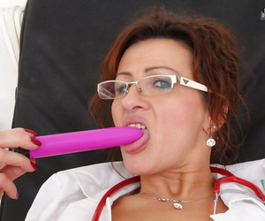 Salacious mature nurse in glasses masturbating her shaved..
