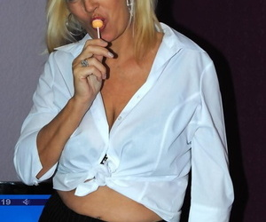 Mature amateur Platinum Blonde bares her tits and twat..