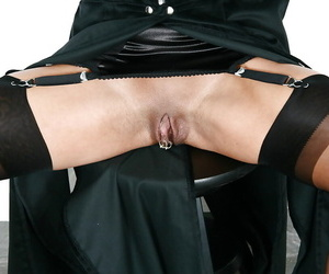 Kinky mature UK BDSM model Lady Sarah flashing pierced..