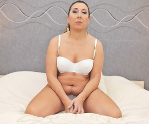 All natural mature granny Jodie spreads her pierced hairy..