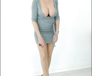 Matrure Lady Sonia poses in her office clothing with naked..