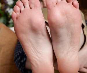 Older redhead Marie McCray displaying bare feet before..