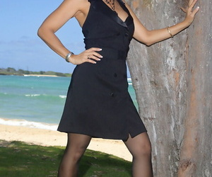 Long legged mature Roni posing on the beach in black lacy..