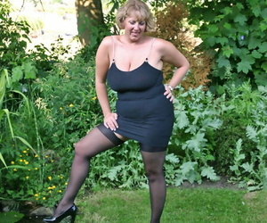 Fat older woman Curvy Claire sets her giant boobs loose in..