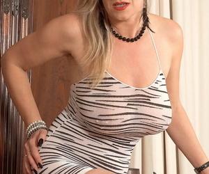 BBW mature model Marina Rene stuffs her piereced cunt and..