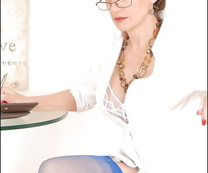 Bottomless mature lady in glasses teasing her slit through..