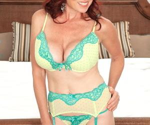 Red-haired mature with big boobs Karen Kougar takes guys..