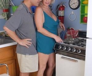 Mature blonde plumper Wanda tit smothering man in kitchen..