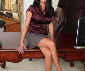 Mature office beauty Veronica Jones undresses pretty sexy..