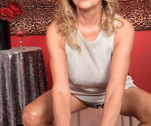 Mature lady Bethany James gets naked while blowing a large..
