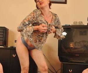 Older redhead Mina Gorey does a sexy striptease before POV..