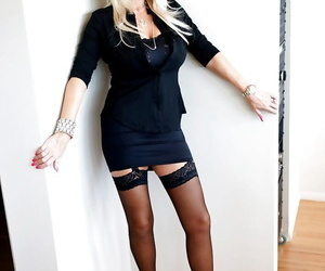 Playful mature blonde in stockings revealing her amazing..