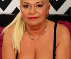 Voluptuous mature woman Betsy B getting naked and dirty in..