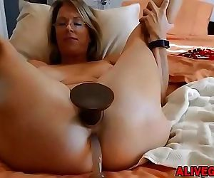 Sensual blond MILF Justy with big gaping pussy lips loves..