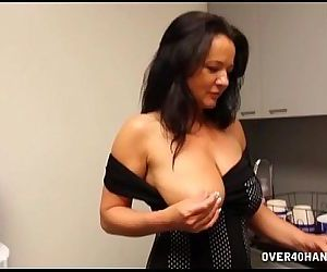 Naughty Milf Stroking In The Kitchen